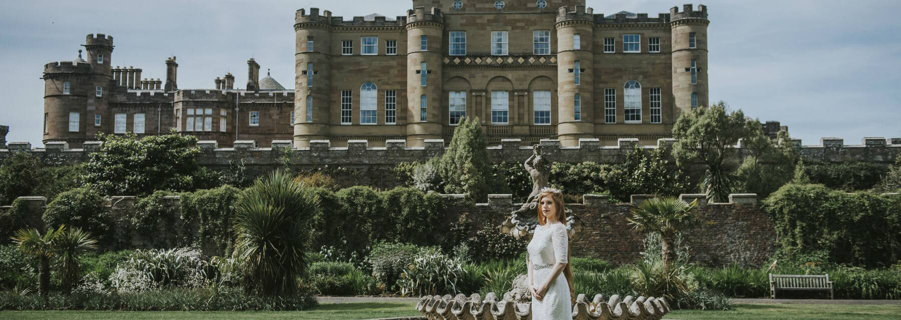 Bride standing in Fountain Court with Culzean Castle forming the backdrop