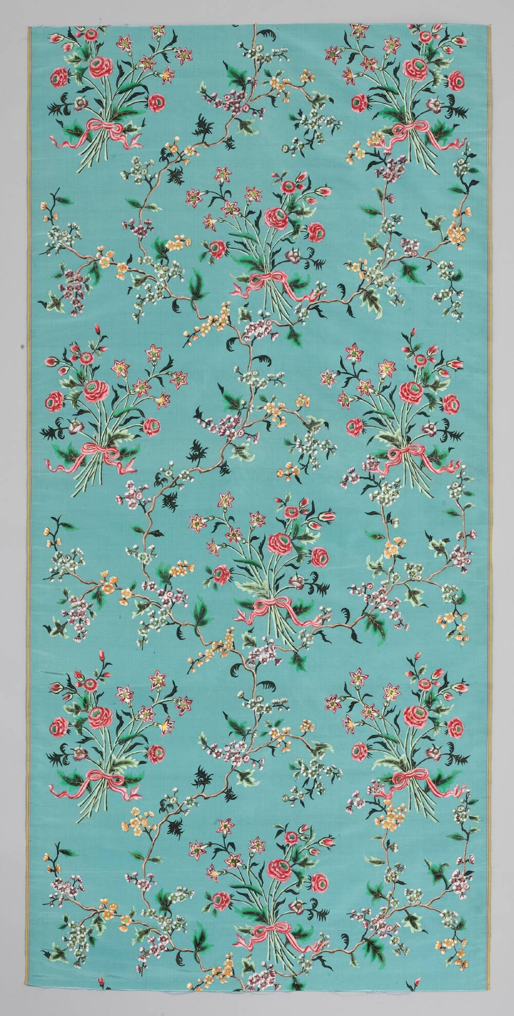 A long vertical panel of turquoise silk with a painted floral design is displayed against a plain grey background.