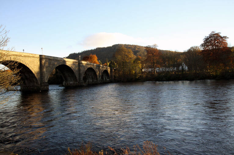 The River Tay running through Dunkeld on a sunny evening