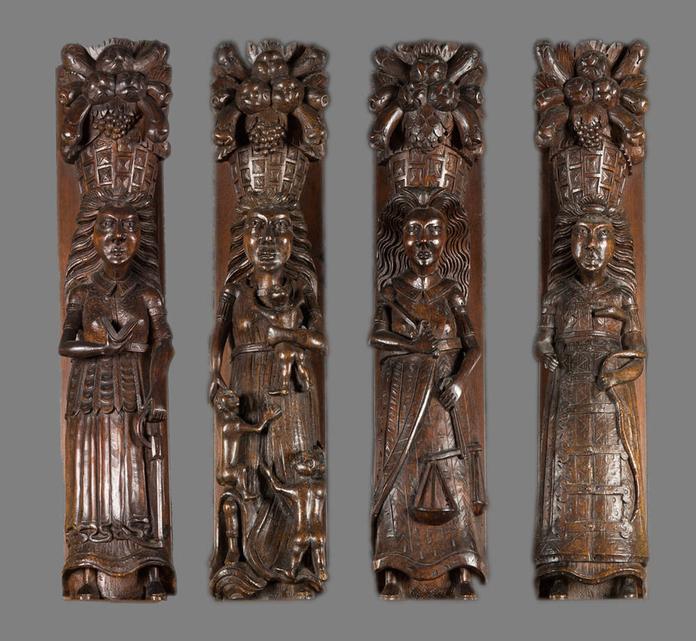 From left to right, the figures of Faith, Charity, Justice and Chastity