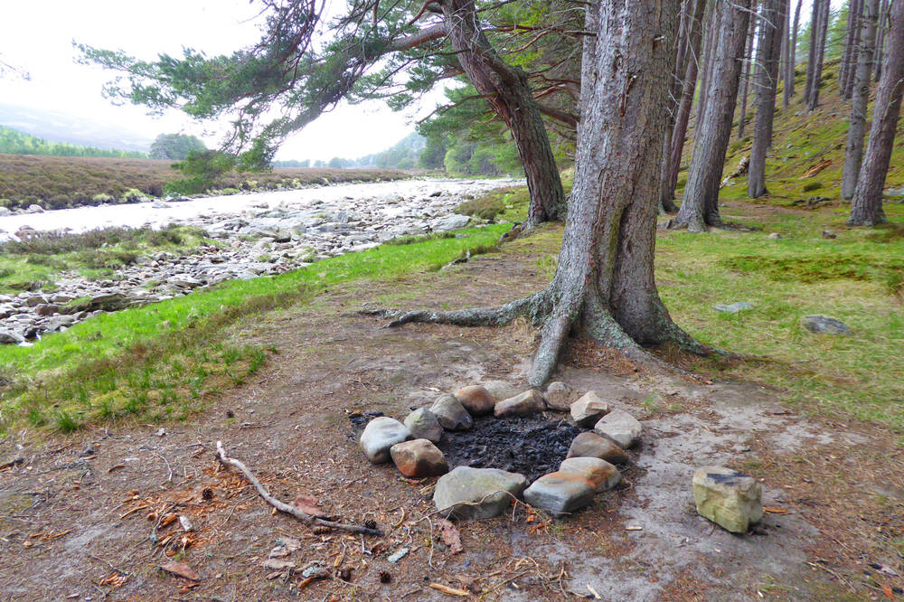 Fire ring by the Dee. Stones won't stop a fire from burning down into the ground