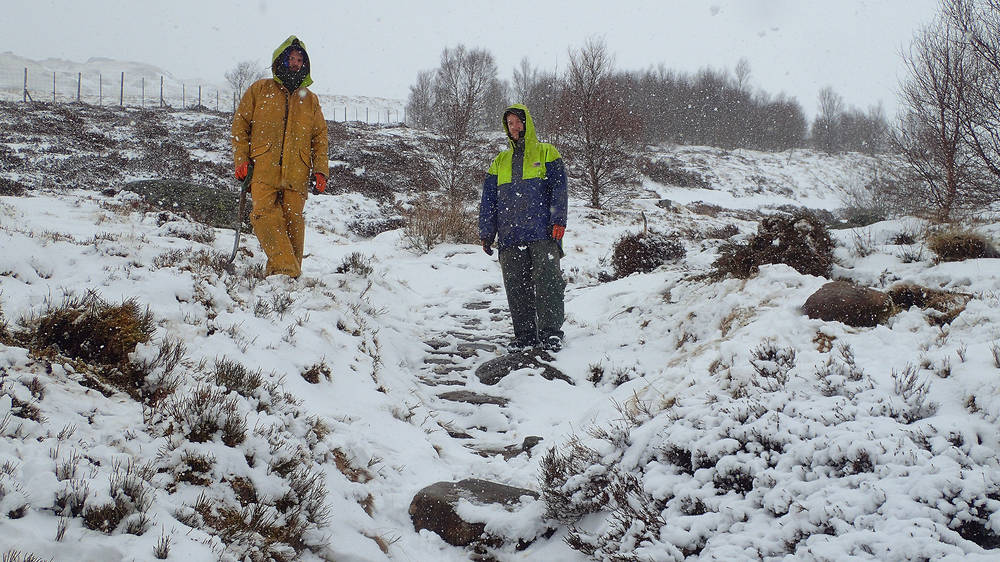 Footpath fund team in snow