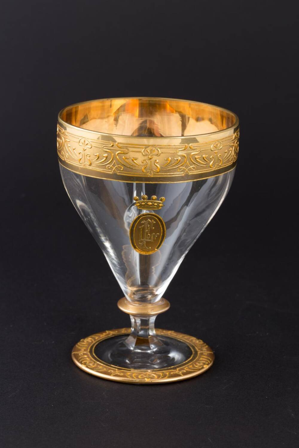 A custard glass from Fyvie Castle. It has a gilt-decorated rim and base. On the side is the gold FL monogram, with a gold crown above.