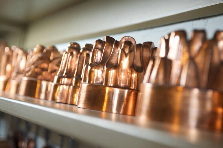 Copper Jelly Moulds on a shelf