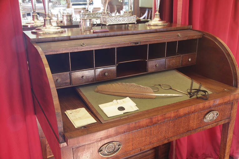 Antique writing desk with period stationery in the Georgian House
