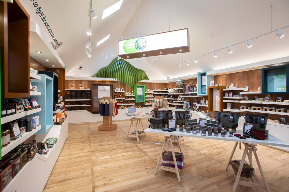 A view of the shop in the visitor centre, with products displayed on shelves and tables.