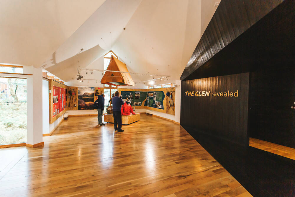 People looking at an exhibition in Glencoe Visitor Centre