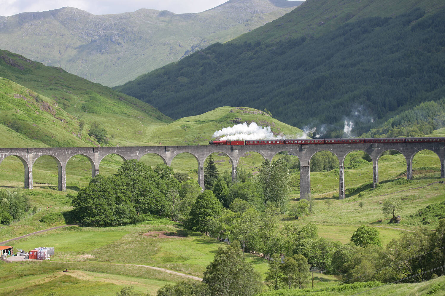 Glenfinnan Viaduct with the steam train going across