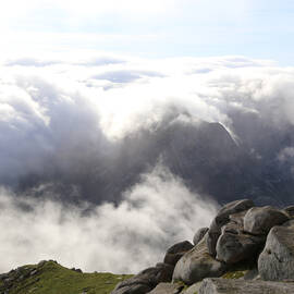 A sunny yet cloudy view from the top of Goatfell
