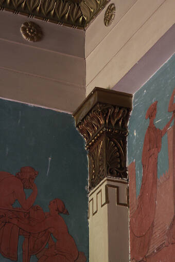 Painted friezes depicting scenes from The Iliad in the dining room