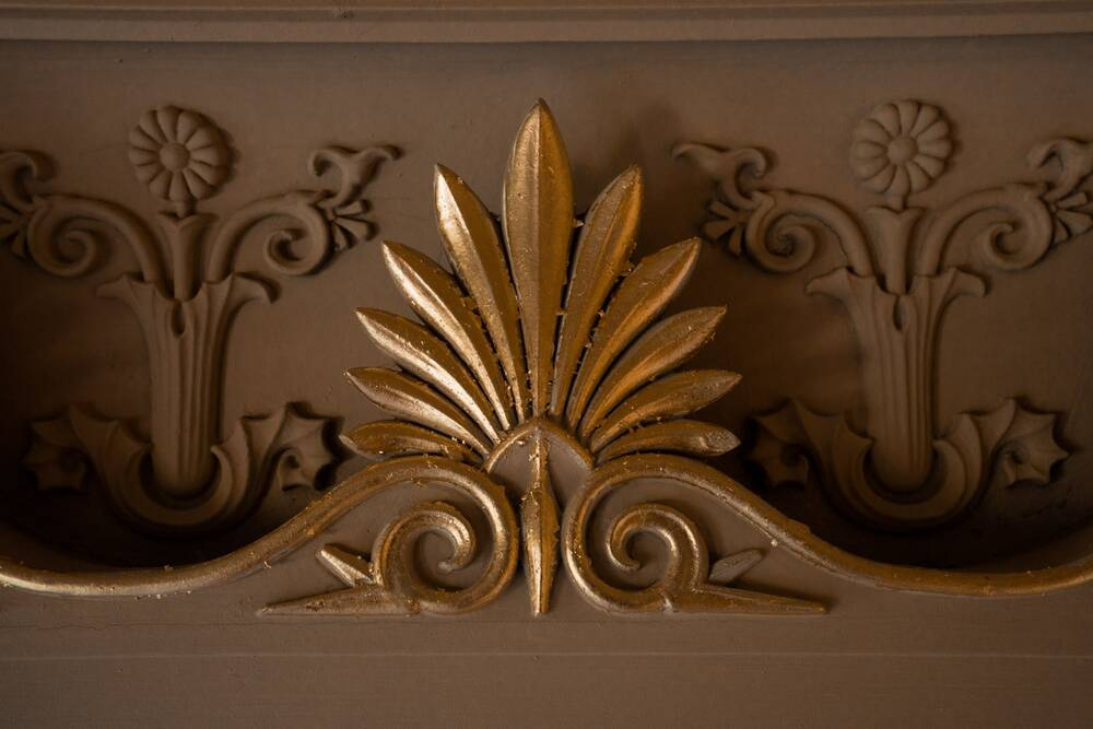 A detail of a gilded decoration in the cupola at Holmwood, shaped like an open fan.