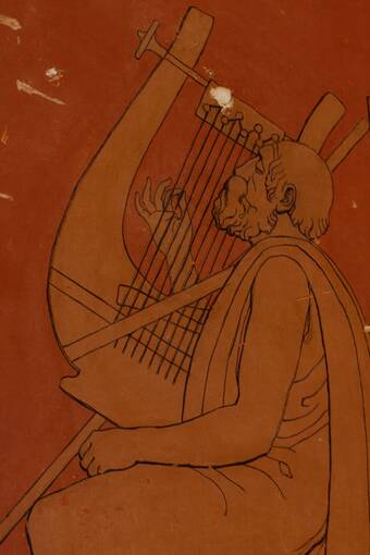 A close-up of a stencilled wall decoration against an orange background. It shows an older bearded man wearing a toga and playing a harp.
