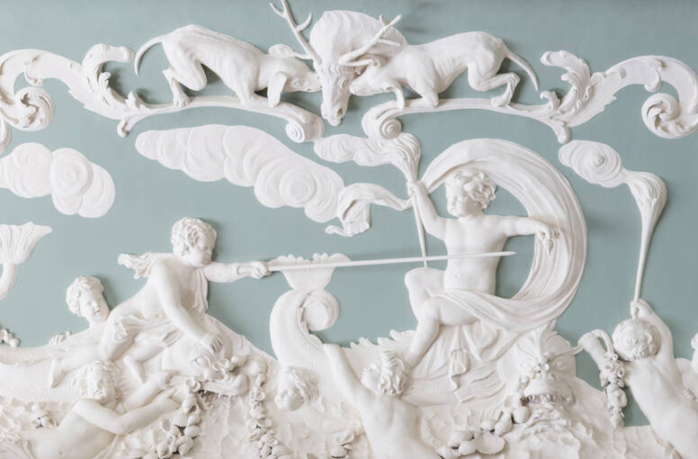 A close-up of the plasterwork at House of Dun. This scene shows several cupid figures, two hounds and a stag.