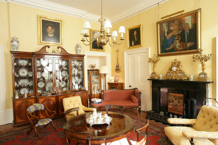 Beautiful furniture, paintings and artefacts adorn a room in the House of the Binns