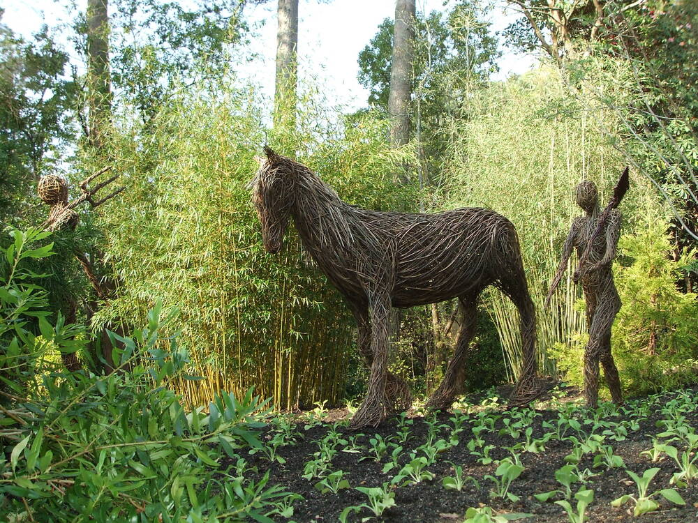 Willow sculptures at Inverewe, representing gardeners and a 'War Horse' leaving for the Western Front in 1914