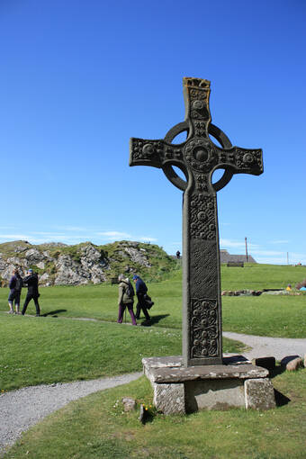 Visitors walking near St John's Cross on Iona