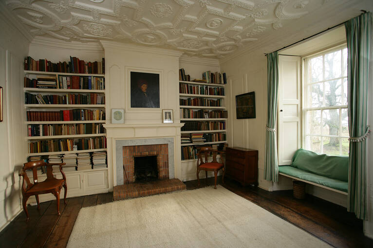 Books fill the shelves in the Kellie Castle library