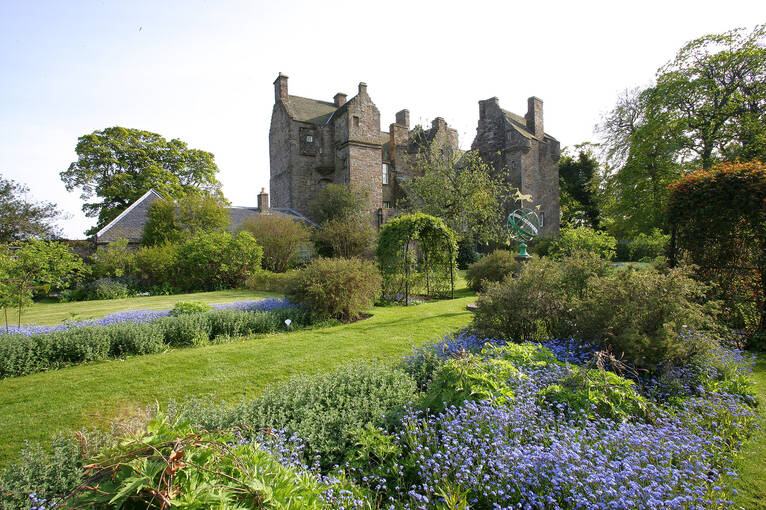 A view of Kellie Castle across the colourful garden