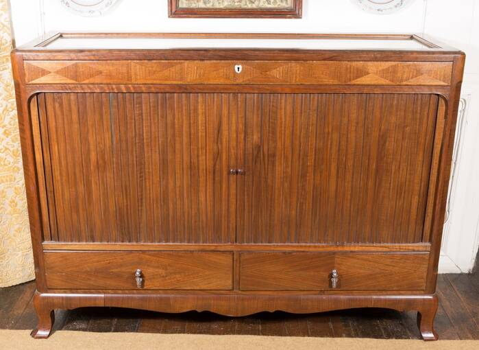 A wooden cabinet with folding wooden doors in the centre and two small drawers at the bottom.