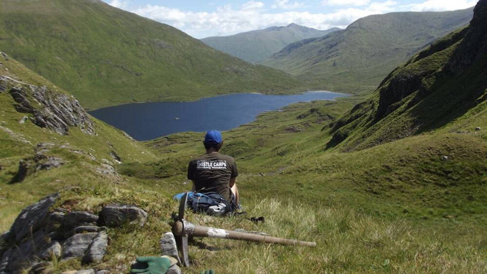 A participant looks down into Glen Affric after a morning clearing cross drains