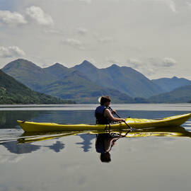 A person enjoying sea kayaking in Loch Duich by Kintail