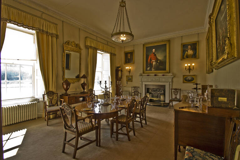 Paintings hang on the wall in the Dining Room of Leith Hall.