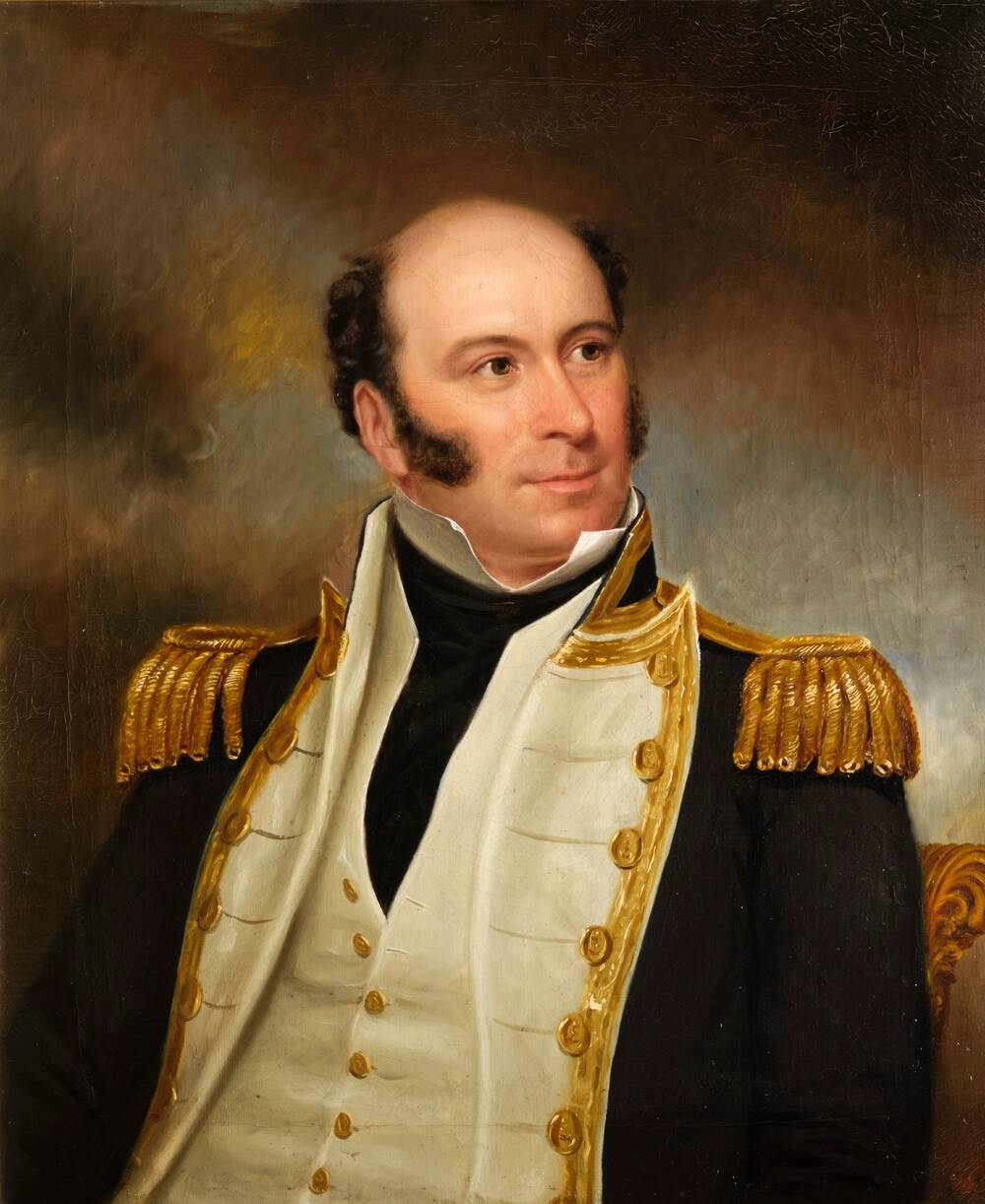 A half portrait of a middle-aged man in naval uniform. He has dark sideburns although is bald on top. He wears a navy jacket with gold trimmings, and a white waistcoat underneath.