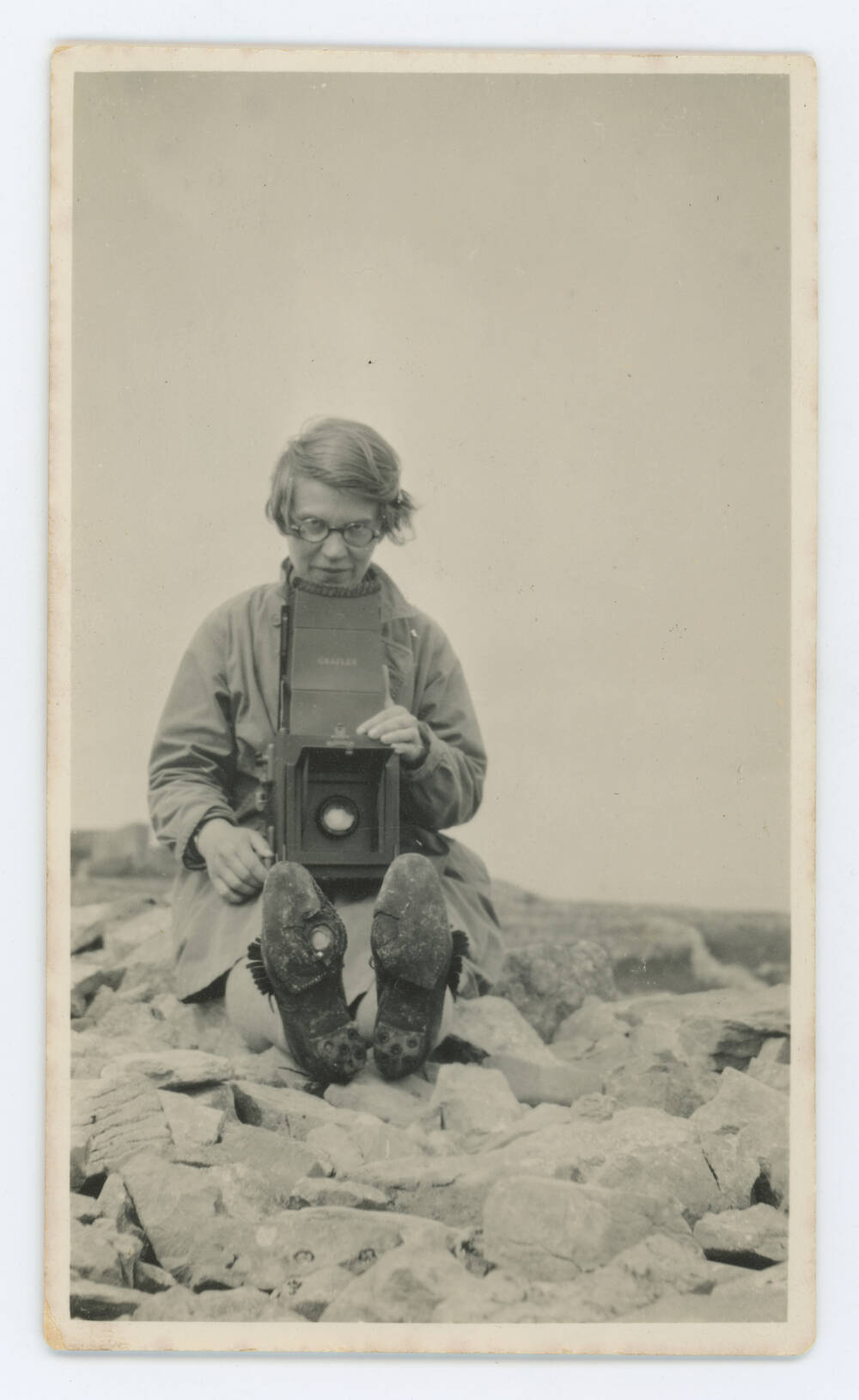 Margaret with her Graflex camera. Inishmore, 1929. This object, along with the rest of the collection, is stored at Canna House, Margaret's home on the Isle of Canna