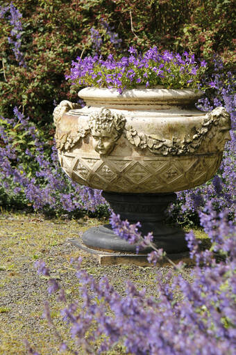 Lavender surrounds a garden ornament in Malleny Garden.
