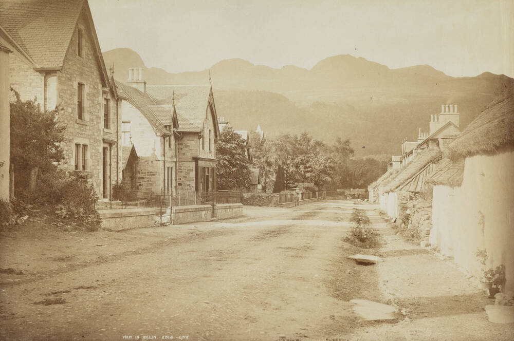 A sepia photograph of the main street of Killin, taken in the early 20th century.
