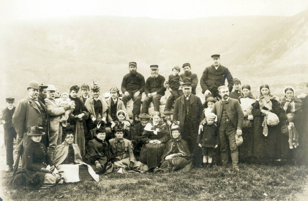 Tourists posing with St Kildans