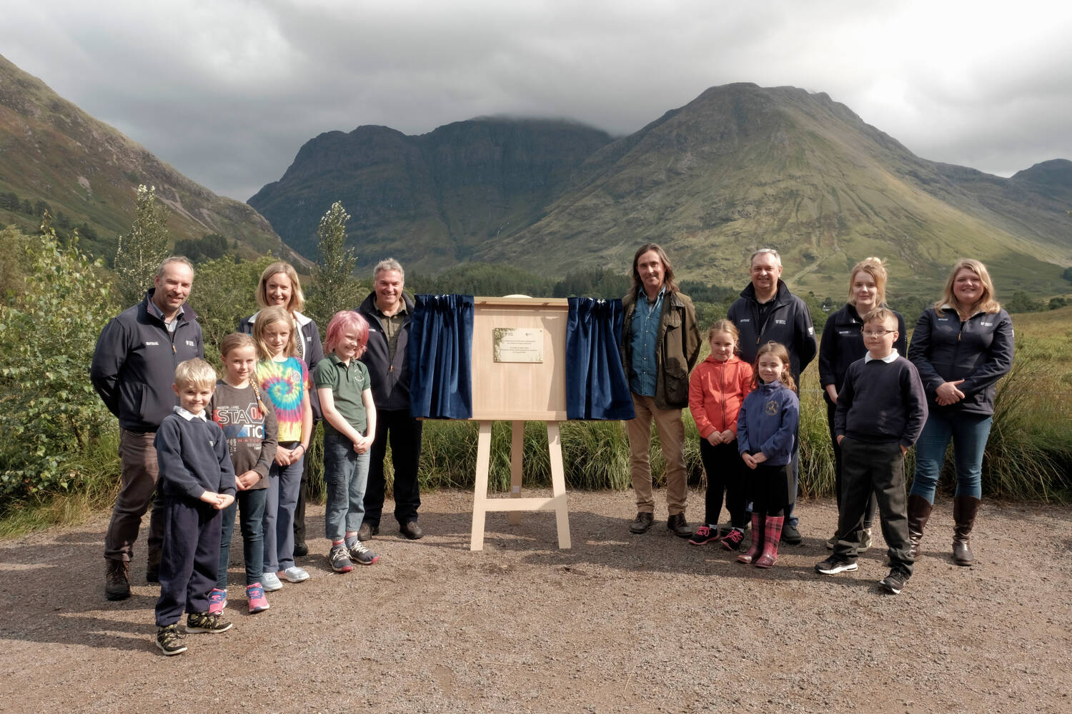 Trust President Neil Oliver unveils a plaque at Glencoe to mark its National Nature Reserve status