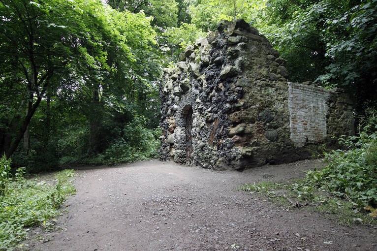 The Shell Grotto stands next to a path in the woodlands of Newhailes.