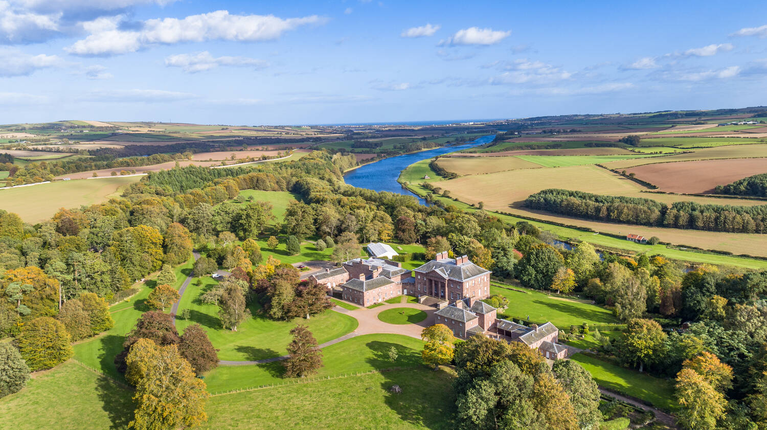 Aerial view of Paxton House and the River Tweed, at the border of Scotland and England