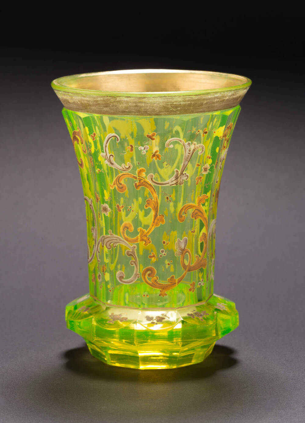 A Vaseline glass showing the distinctive bright green colour