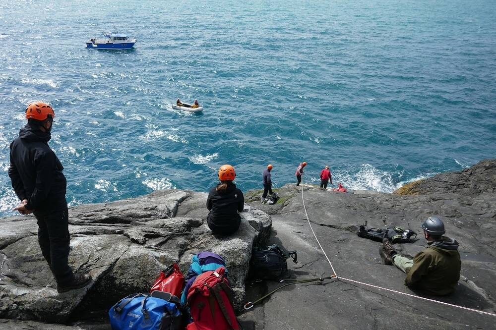 Rope-access specialists, Dan Watson and Paul Thompson help the rest of the team onto Boreray