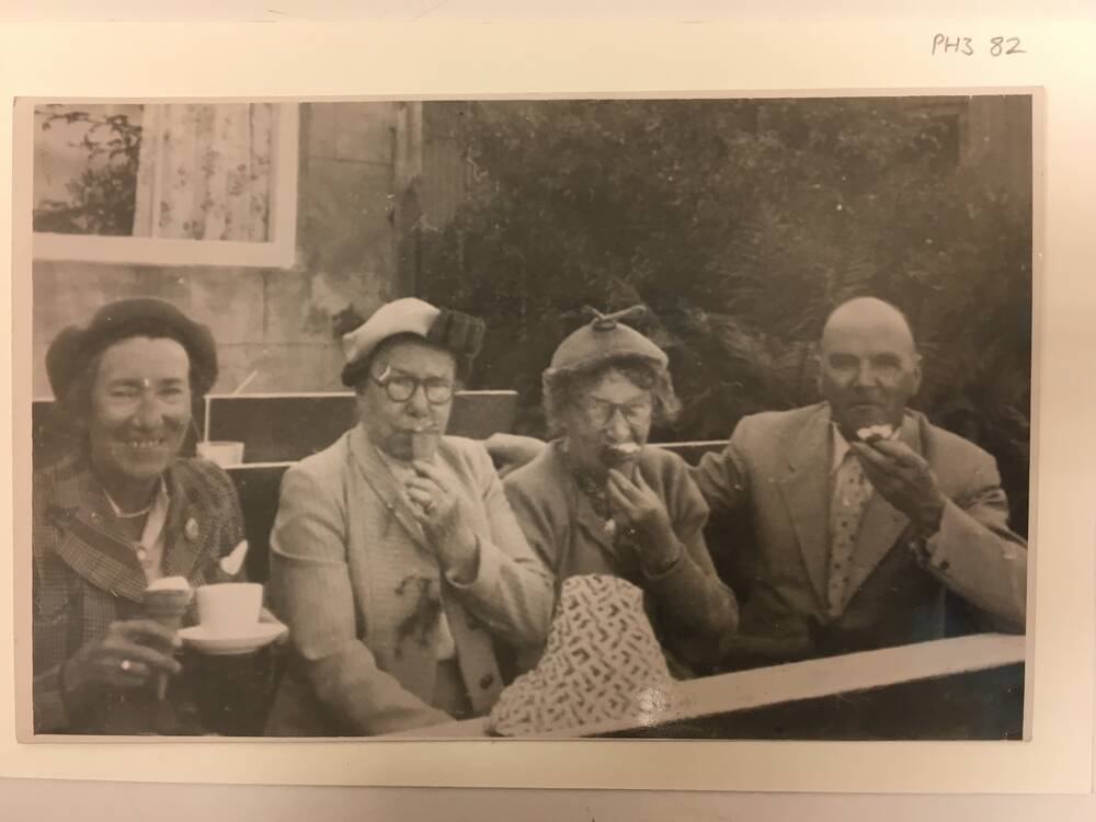 A photograph of Miss Toward and friends, from the collection at the Tenement House.