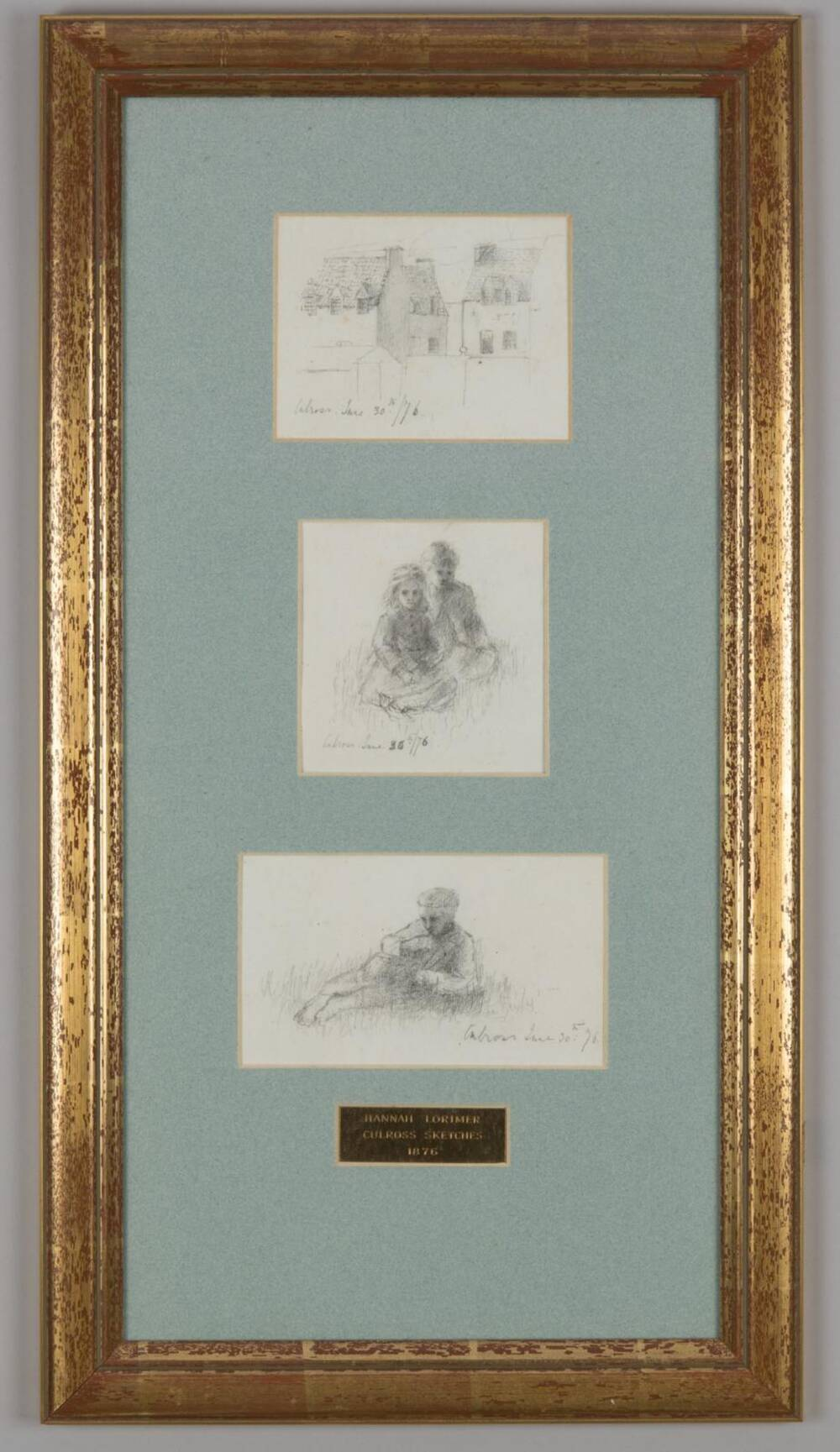 Three sketches by Hannah Lorimer, one of Culross Palace and two of children sitting in the grass, dated 1876. They're mounted on a green background inside a gold frame.