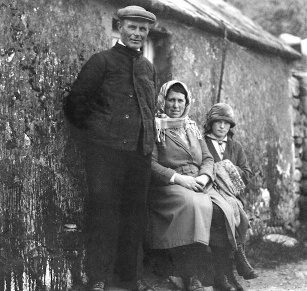 Margaret took several photos during her visit to St Kilda, including this one of a family outside one of the cottages on The Street