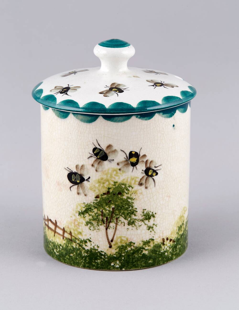 Wemyss Ware honey pot, showing the traditional bee design