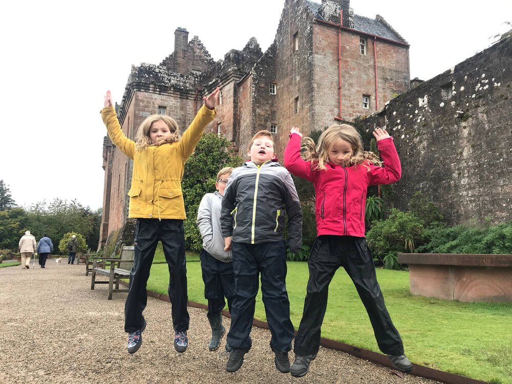 Children playing in front of Brodick Castle, Arran