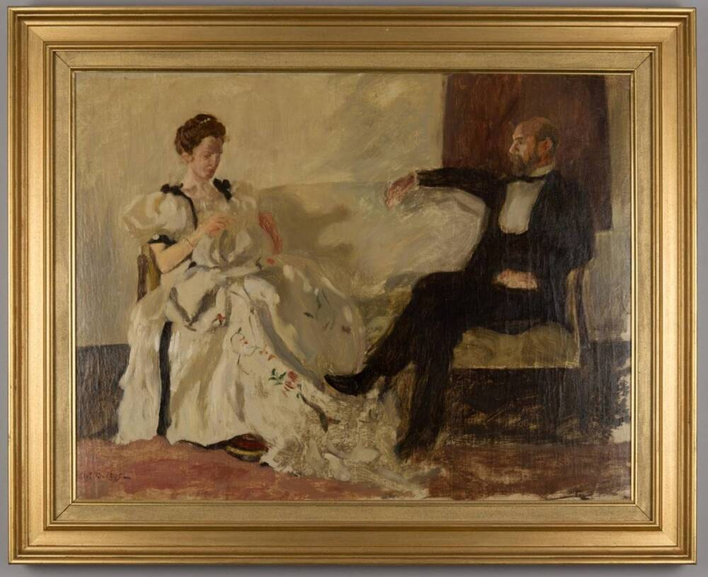 An oil painting of a woman and a man sitting on a pale sofa. The woman wears a white dress, and is embroidering a piece of white cloth in her lap. The man wears a dark suit.