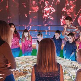 Children playing the digital battlefield table at Bannockburn