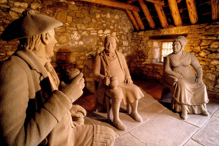The model tavern in the garden with life-sized statues of Souter Johnnie and his wife