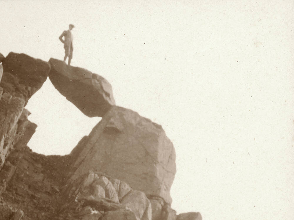R Milne rock climbing on Hirta, St Kilda; photographed by R Milne in 1907