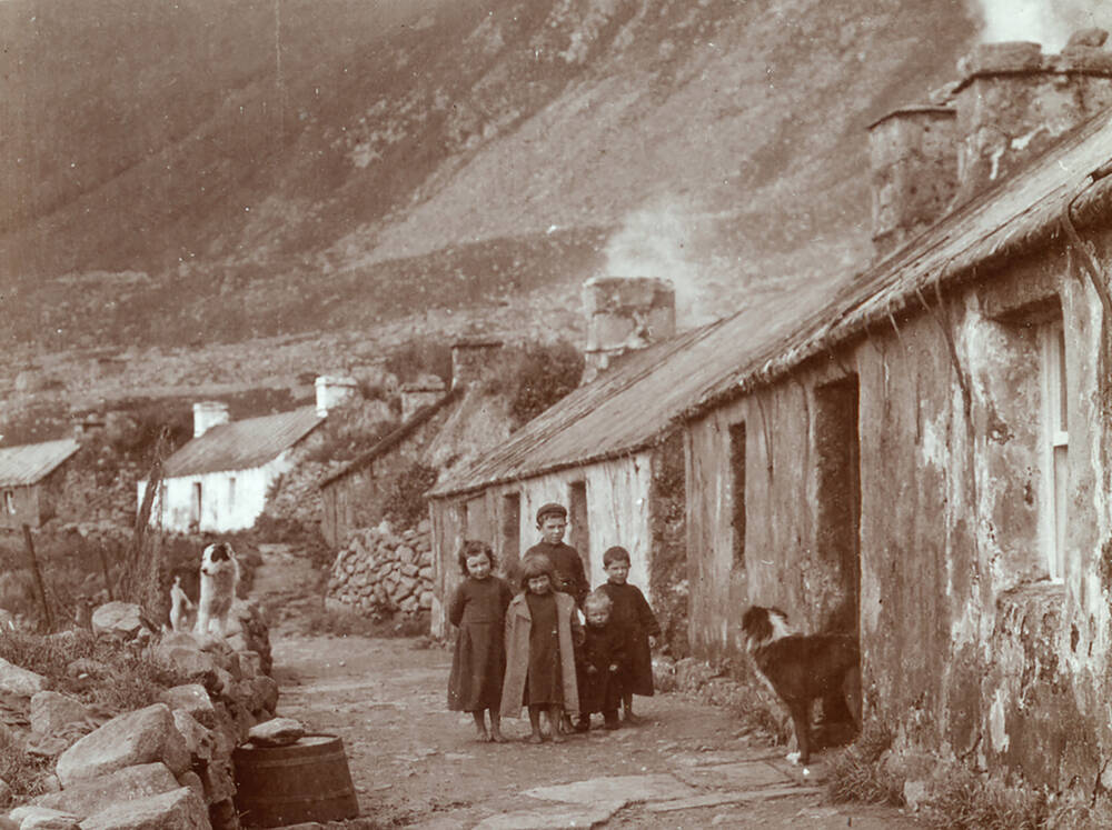 Children standing in the main street of the village on Hirta, St Kilda; photographed by R Milne in 1907