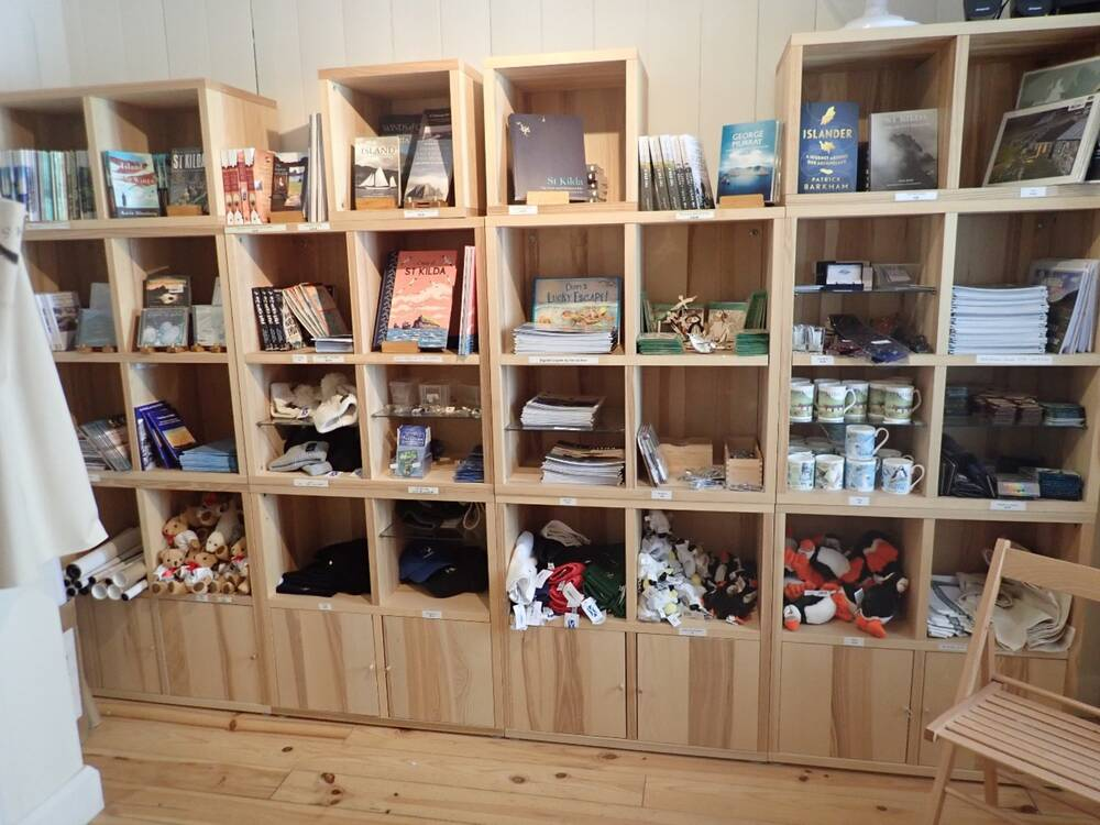 Shelves in the St Kilda shop holding books, soft toys and other souvenirs