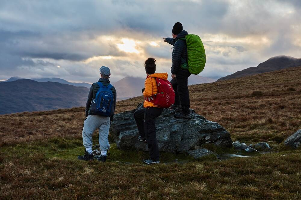 Climbers take in the views along the way during the Torchlight Challenge