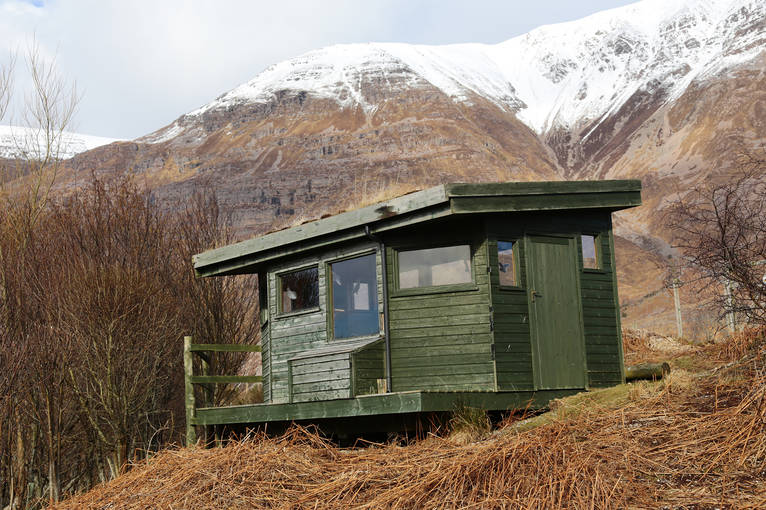 A bird hide sits at the edge of Loch Torridon.