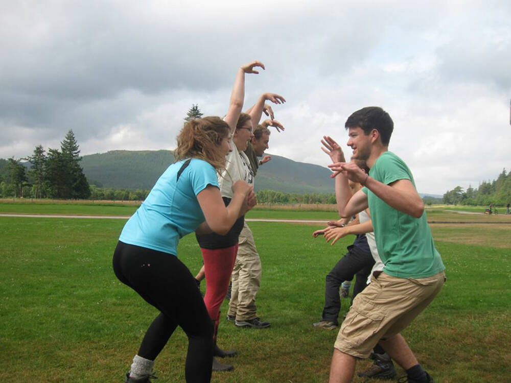 Participants playing 'wildcat, salmon, midge', which is a version of 'rock, paper, scissors' with an environmental angle